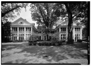 A black-and-white photograph of the Duke Mansion. The ghosts of Duke Mansion, including the polio-stricken spirit of Jon Avery are said to haunt its halls.