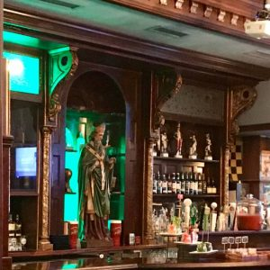 A wooden St. Patrick watches over the haunted Ri Ra Pub in Charlotte. The pub is rumored to be haunted by ghostly Irishmen and Victorian girls alike.